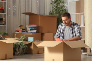 man packing boxes